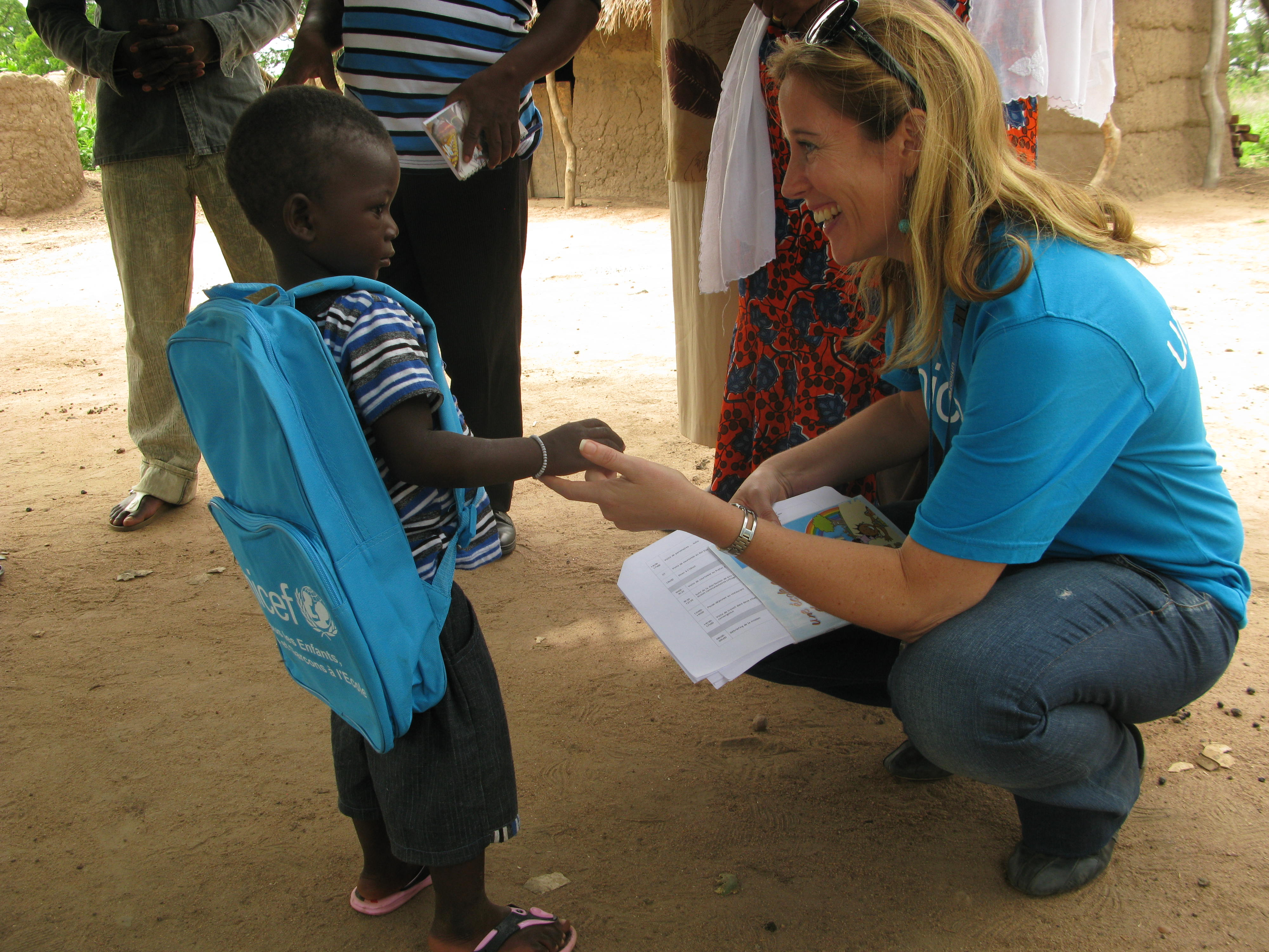 Christina de Bruin greets young boy in Côte d'Ivoire, Ivory Coast.