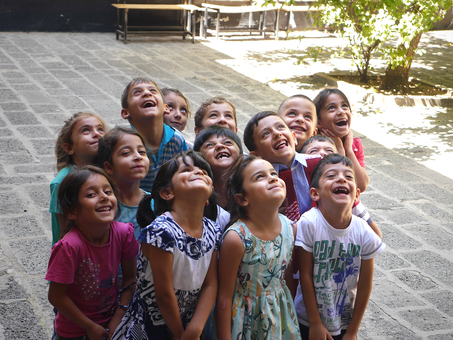 Happy Turkish school children look toward the sky and a brighter future.