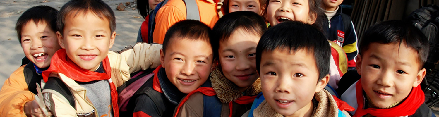 Smiling young Chinese children who've just been let out of school gather on a road in the small Sichuan Province, China village of Li An. © Lei Xu | Dreamstime Images