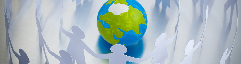 Paper figures join hands around globe. © Grondin Franck Olivier | Dreamstime Images