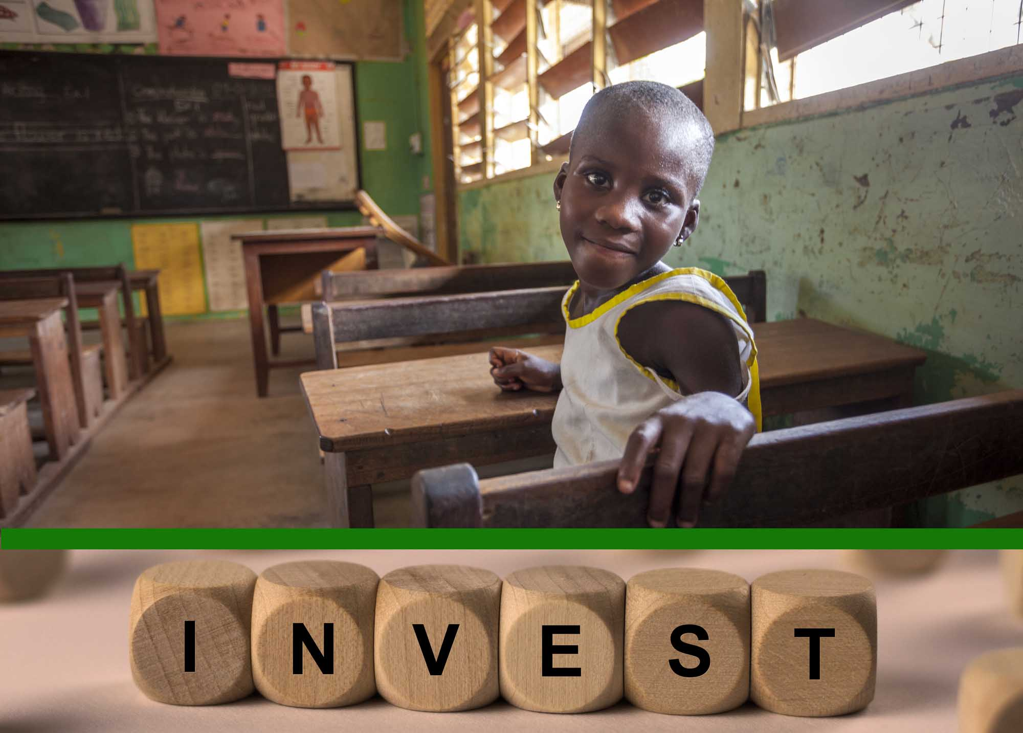 Young girl sits by her desk in primary school in Akosombo, Ghana, W. Africa.