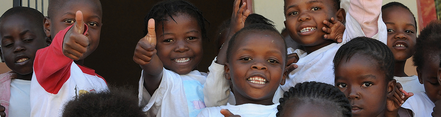 Mozambique refugee school children give thumbs up (South Africa). © Martin Applegate   Dreamstime Images