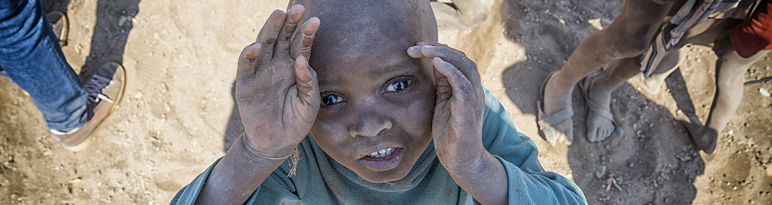 Himba child looks toward sky and a hopeful future. © Nikovfrmoto | Dreamstime Images
