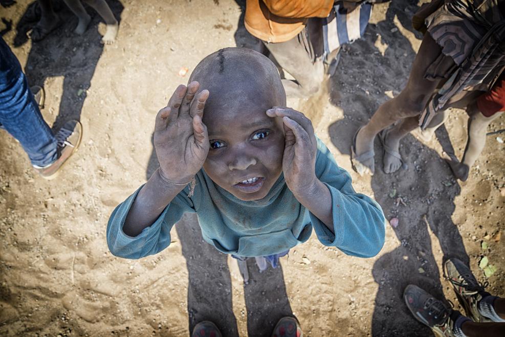 Nimba (Africa) child looks toward the sky for a hopeful future.