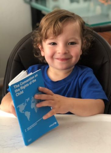 Two-year-old Franco reads from the Convention on the Rights of the Child. © 2019 Photo: Rana Turk Churillo