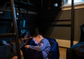 Joseph Calise, 9, plays on his iPad in his bedroom. Joseph used to get anxious whenever he was alone, even when taking a shower or at bedtime, so his parents, Jessica and Chris Calise, learned new parenting skills from the Yale Child Study Center. Christopher Capozziello for NPR