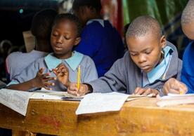 Primary school students in Mathare, Kenya, work on their lessons.