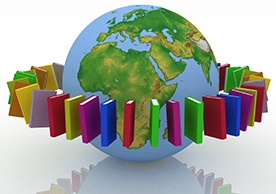 Colorful books encircle a globe.
