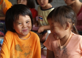 Two young happy girls (Chiang Mai, Thailand).