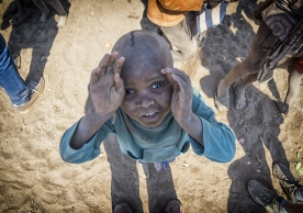 Himba child looks toward sky and a hopeful future.