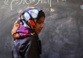 © UNICEF/UN0212108/Mohammadi Afghanistan's education system has been devastated by more than three decades of sustained conflict. For many of the country's children, completing primary school remains a distant dream. Here, 10-year-old Fatima is on the board to solve a math question, at the ALC in Baghe Mellat, Herat.