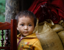 Young inquisitive boy stands in front of his home (Sapa Town, Lao Cai province,Vietnam).