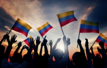 People raise many flags of Colombia in support of building a culture of peace.