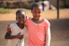 Two happy Ugandan school children participate in UNICEFs PBEA program.