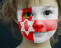 Portrait of a young girl with a painted flag of Northern Ireland. © djem, 123RF Images