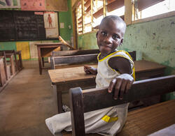 Young Sophia sits at her desk in primary school.