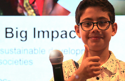 """Rehan Bigzad gives thumbs up at """"Small Asks for BIG Impact"""" HLPF2019 event. Photo by Erica Wong."""