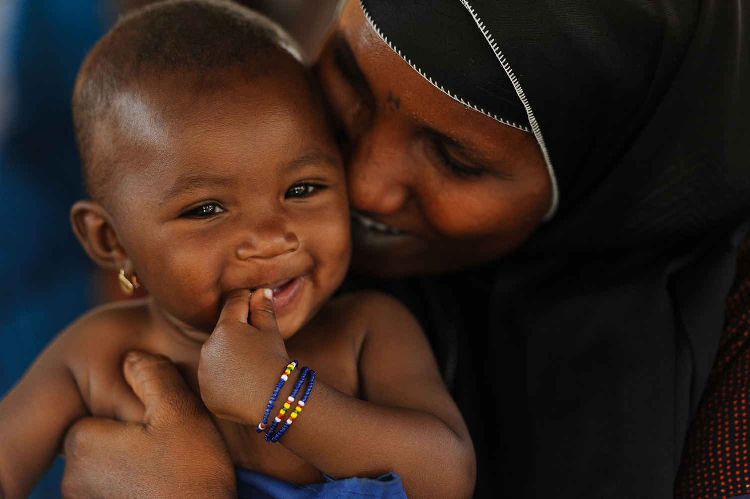 Six-month-old Maniratou Mahamadou, held by her mother, Habsatou Salou, smiles after a nutrition screening at the Boukoki Integrated Health Centre in Niamey, the capital of Niger.